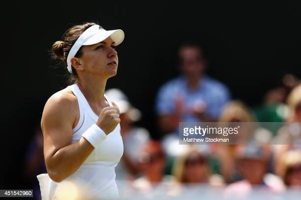 Simona Halep of Romania celebrates after winning her Ladies' Singles fourth round match against Zarina Diyas of Kazakhstan on day eight of the...