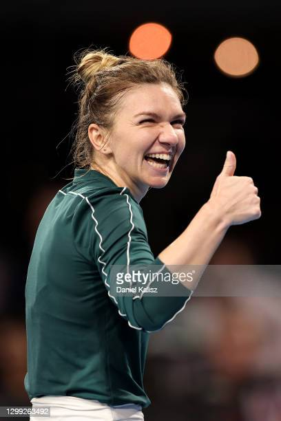 Simona Halep of Romania celebrates after winning her match against Ashleigh Barty of Australia during the 'A Day at the Drive' exhibition tournament...