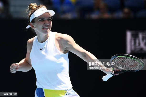 Simona Halep of Romania celebrates after winning match point after her Women's Singles fourth round match against Elise Mertens of Belgium on day...