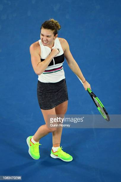 Simona Halep of Romania celebrates after winning match point in her second round match against Sofia Kenin of the United States during day four of...