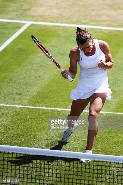 Simona Halep of Romania celebrates after winning the Ladies' Singles second round match against Lesia Tsurenko of Ukraine on day five of the...