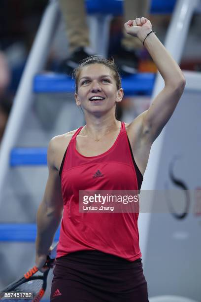 Simona Halep of Romania celebrates after winning the Maria Sharapova of Russia during the Women's singles 3rd round on day five of 2017 China Open at...