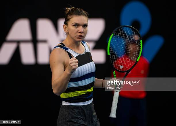Simona Halep of Romania celebrates against Venus Williams of the United States during day six of the 2019 Australian Open at Melbourne Park on...