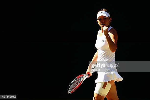 Simona Halep of Romania celebrates during her Ladies' Singles semifinal match against Eugenie Bouchard of Canada on day ten of the Wimbledon Lawn...