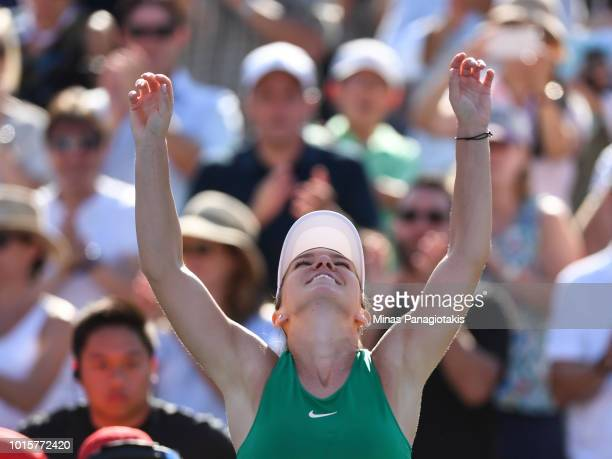 Simona Halep of Romania celebrates her 76 36 64 victory against Sloane Stephens in the final during day seven of the Rogers Cup at IGA Stadium on...