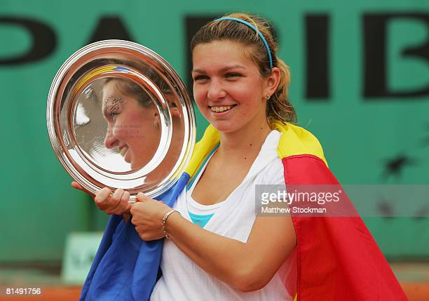 Simona Halep of Romania celebrates her victory during the Girl's Singles Final match against Elena Bogdan of Romania on day fifteen of the French...
