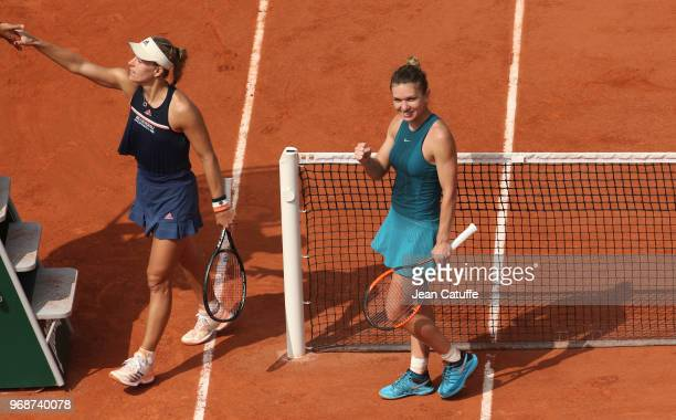 Simona Halep of Romania celebrates her victory while Angelique Kerber of Germany shakes hands with the umpire during Day 11 of the 2018 French Open...