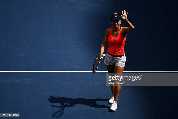 Simona Halep of Romania celebrates her win over Kirsten Flipkens of Belgium in her first round Women's Singles match on Day Two of the 2016 US Open...