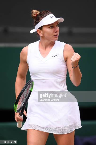 Simona Halep of Romania celebrates in her Ladies' Singles final against Serena Williams of The United States during Day twelve of The Championships...