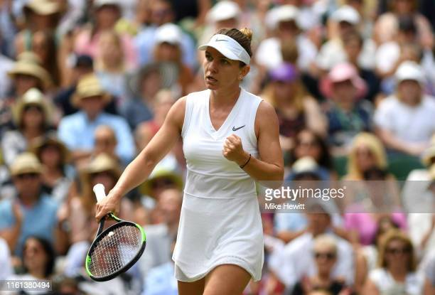 Simona Halep of Romania celebrates in her Ladies' Singles semifinal match against Elina Svitolina of Ukraine during Day Ten of The Championships...