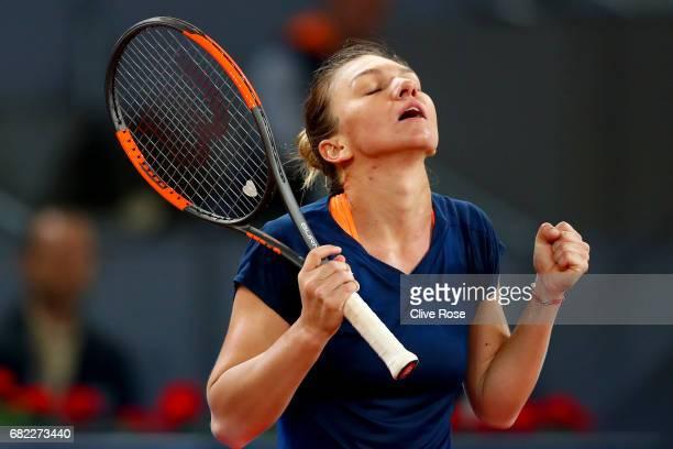 Simona Halep of Romania celebrates match point against Anastasija Sevastova of Latvia in the semi finals during day seven of the Mutua Madrid Open...