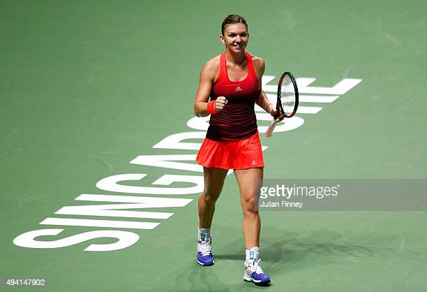 Simona Halep of Romania celebrates match point against Flavia Pennetta of Italy in a round robin match during the BNP Paribas WTA Finals at Singapore...