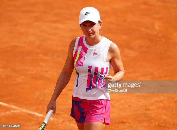 Simona Halep of Romania celebrates match point in her semi-final match against Garbine Muguruza of Spain during day seven of the Internazionali BNL...