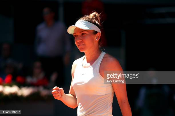 Simona Halep of Romania celebrates victory during her ladies singles semifinal match against Belinda Bencic of Switzerlandduring day seven of the...