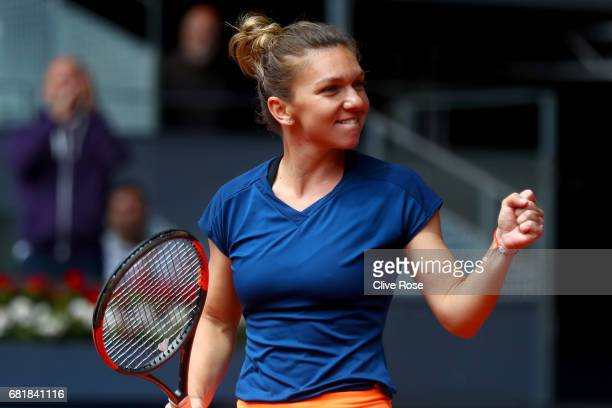 Simona Halep of Romania celebrates victory during her match against CoCo Vandeweghe of USA on day six of the Mutua Madrid Open tennis at La Caja...