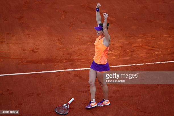 Simona Halep of Romania celebrates victory during her women's singles match against Andrea Petkovic of Germany on day twelve of the French Open at...