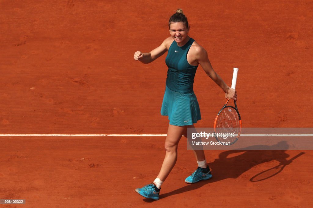 Simona Halep of Romania celebrates victory following her ladies singles quarter finals match against Angelique Kerber of Germany during day eleven of the 2018 French Open at Roland Garros on June 6, 2018 in Paris, France.