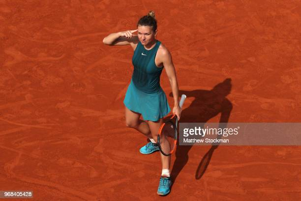 Simona Halep of Romania celebrates victory following her ladies singles quarter finals match against Angelique Kerber of Germany during day eleven of...