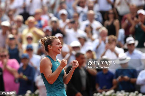 Simona Halep of Romania celebrates victory following the ladies singles final against Sloane Stephens of The United States during day fourteen of the...