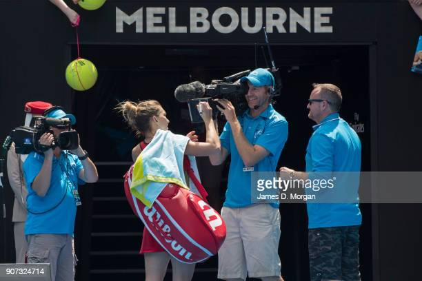 Simona Halep of Romania celebrates victory in her 3 hour 45 minute match against Lauren Davis of the United States on day six of the 2018 Australian...