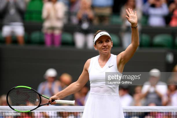 Simona Halep of Romania celebrates victory in her Ladies' Singles Quarter Final match against Shuai Zhang of China during Day Eight of The...