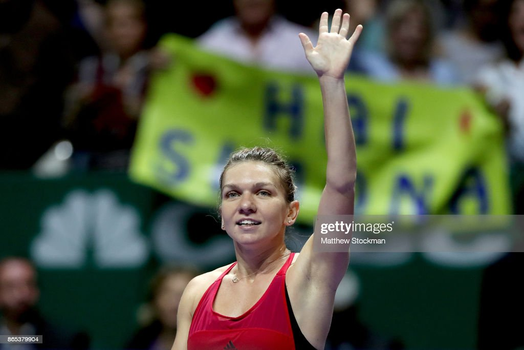Simona Halep of Romania celebrates victory in her singles match against Caroline Garcia of France during day 2 of the BNP Paribas WTA Finals Singapore presented by SC Global at Singapore Sports Hub on October 23, 2017 in Singapore.