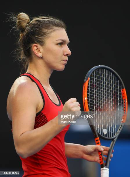 Simona Halep of Romania celebrates winning a point in her second round match against Eugenie Bouchard of Canada on day four of the 2018 Australian...