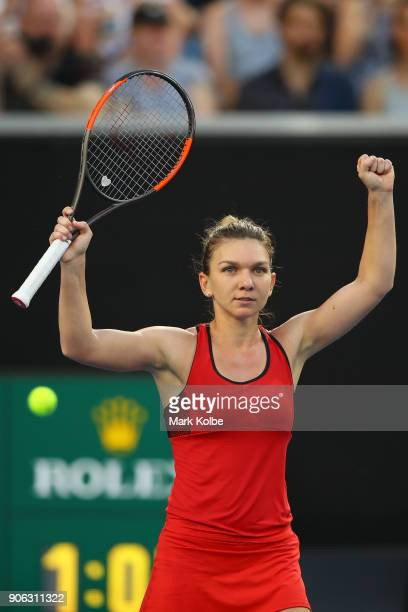 Simona Halep of Romania celebrates winning her second round match against Eugenie Bouchard of Canada on day four of the 2018 Australian Open at...