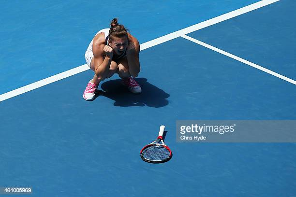 Simona Halep of Romania celebrates winning in her fourth round match against Jelena Jankovic of Serbia during day eight of the 2014 Australian Open...