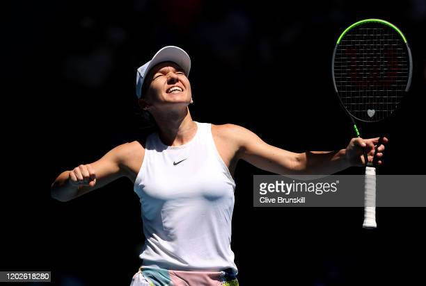 Simona Halep of Romania celebrates winning match point during her Women's Singles Quarterfinal match against Anett Kontaveit of Estonia on day ten of...