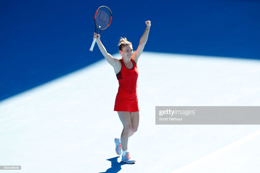 Simona Halep of Romania celebrates winning match point in her quarter-final match against Karolina Pliskova of the Czech Republic on day 10 of the 2018 Australian Open at Melbourne Park on January 24, 2018 in Melbourne, Australia.