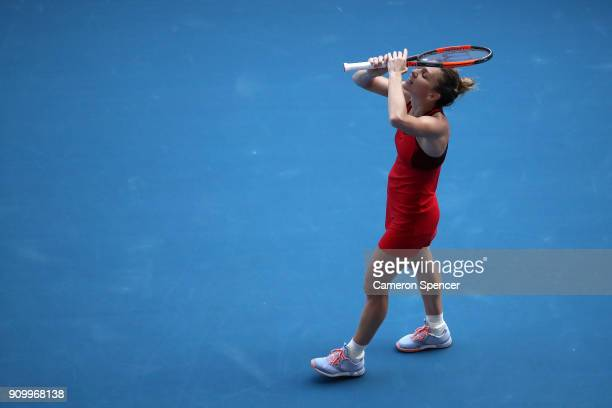 Simona Halep of Romania celebrates winning match point in her semifinal match against Angelique Kerber of Germany on day 11 of the 2018 Australian...