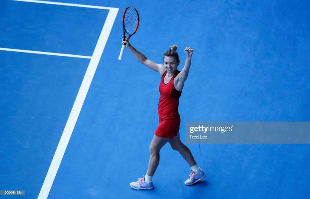 Simona Halep of Romania celebrates winning match point in her semi-final match against Angelique Kerber of Germany on day 11 of the 2018 Australian Open at Melbourne Park on January 25, 2018 in Melbourne, Australia.