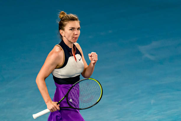 Simona Halep of Romania celebrates winning set point in her Women's Singles fourth round match against Iga Swiatek of Poland during day seven of the...