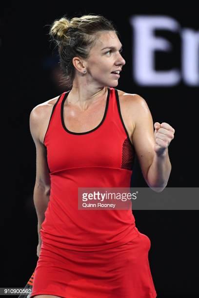 Simona Halep of Romania celebrates winning set point in her women's singles final against Caroline Wozniacki of Denmark on day 13 of the 2018...