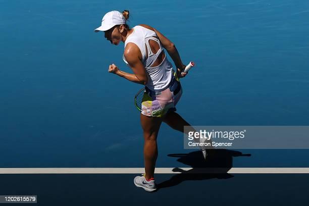 Simona Halep of Romania celebrates winning the first set during her Women's Singles Quarterfinal match against Anett Kontaveit of Estonia on day ten...