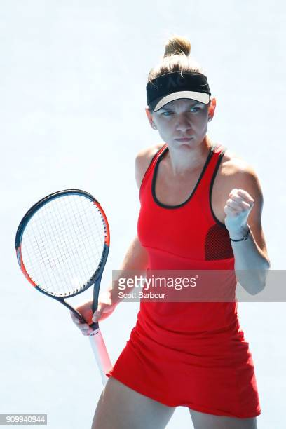 Simona Halep of Romania celebrates winning the first set in her semifinal match against Angelique Kerber of Germany on day 11 of the 2018 Australian...