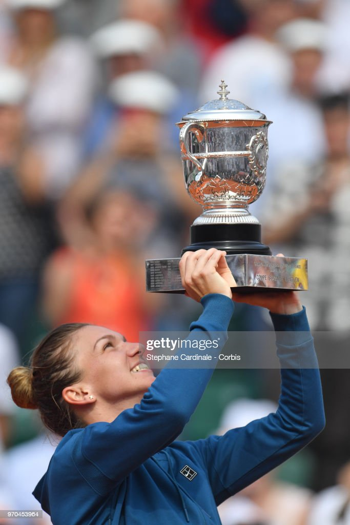 Simona Halep of Romania celebrates with the trophy after beating Sloane Stephens of the United States 3-6 6-4 6-1 in the final of the women's singles at Roland Garros during the French Open a on June 9, 2018 in Paris, France.