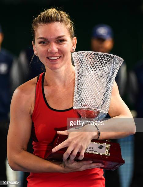 Simona Halep of Romania celebrates with the trophy after her victory against Katerina Siniakova of the Czech Republic in the women's singles final...