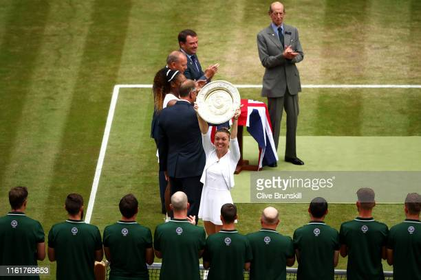 Simona Halep of Romania celebrates with the trophy after winning the Ladies' Singles final against Serena Williams of The United States during Day...