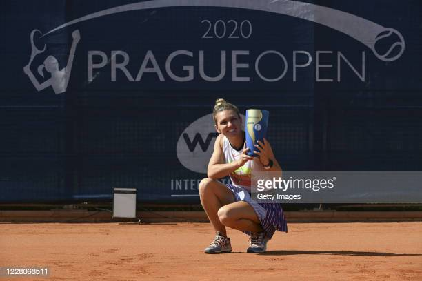 Simona Halep of Romania celebrates with the trophy after winning the Women's Singles Final against Elise Mertens of Belgium during the WTA Prague...