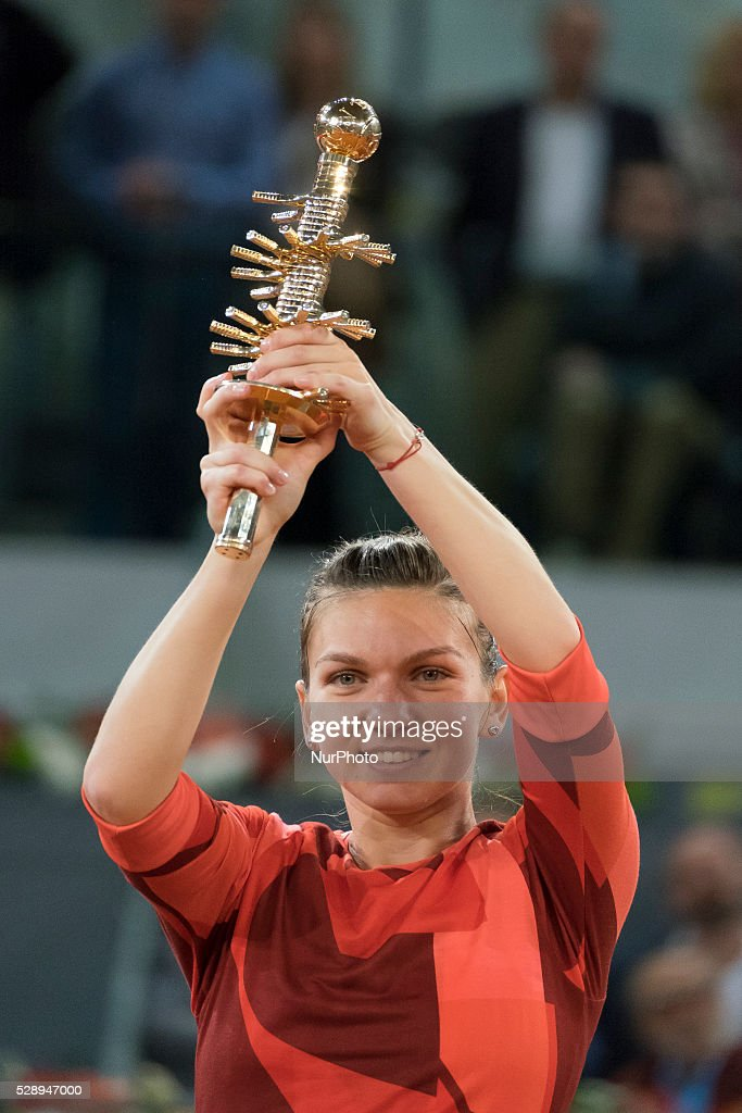 Simona Halep of Romania celebrates with the winners trophy after her win over Dominika Cibulkova of Slovakia in the final during day eight of the Mutua Madrid Open tennis tournament at the Caja Magica on May 07, 2016 in Madrid, Spain.