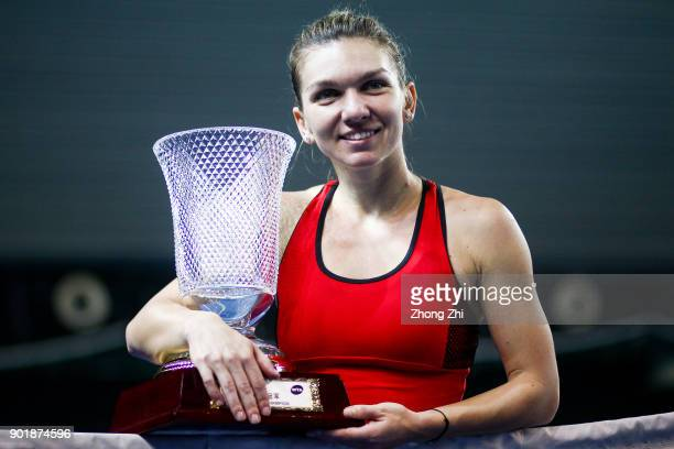 Simona Halep of Romania celebrates with trophy after winning the final match against Katerina Siniakova of Czech Republic during Day 7 of 2018 WTA...