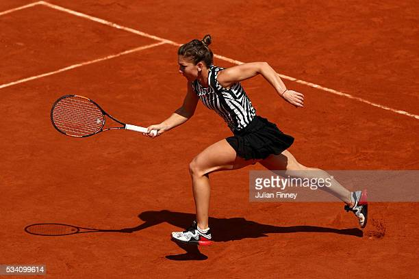 Simona Halep of Romania chases down the ball during the Ladies Singles second round match against Zarina Diyas of Kazakhstan at Roland Garros on May...