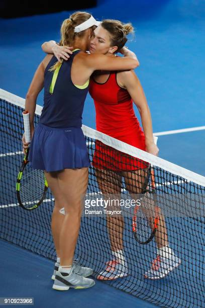 Simona Halep of Romania congratulates Caroline Wozniacki of Denmark after Wozniacki won their women's singles final on day 13 of the 2018 Australian...