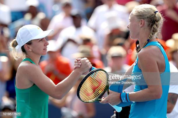 Simona Halep of Romania congratulates Kiki Bertens of Netherlands after their match during the women's final of the Western Southern Open at Lindner...