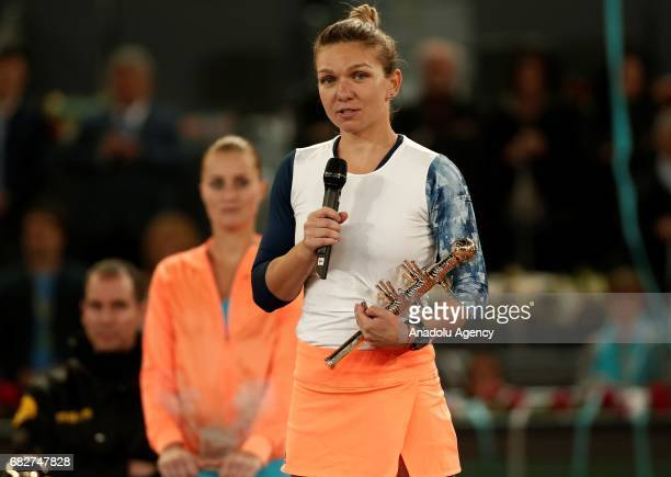 Simona Halep of Romania delivers a speech as she holds her trophy after she won the Mutua Madrid Open final tennis match against Kristina Mladenovic...
