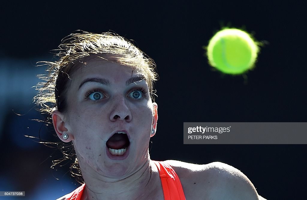 TOPSHOT - Simona Halep of Romania eyes a return against Karolina Pliskova of the Czech Republic during their women's singles third round match at the Sydney International tennis tournament in Sydney on January 13, 2016. AFP PHOTO / Peter PARKS PARKS