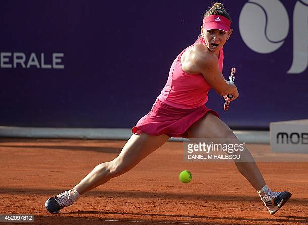 Simona Halep of Romania eyes the ball during the single final at the WTA Bucharest tennis tournament in Bucharest on July 13 2014 Halep won against...