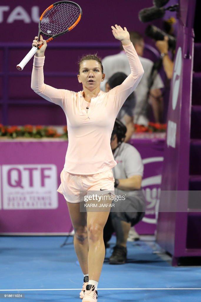 Simona Halep of Romania gestures after defeating Anastasija